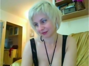 Mature blonde is on webcam and doing a show and stripping