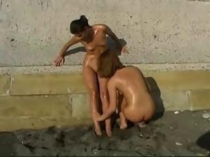2 Nudist Girls with Sunscreenlotion
