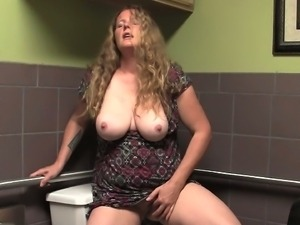 Mature slut masturbates on the toilet