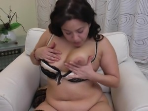 mature chubby woman licks her nipples