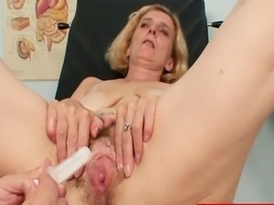Aged blond amateur get her hairy pussy examined with various gyno tools by...