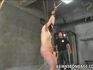 tied asian milf beaten with bamboo sticks
