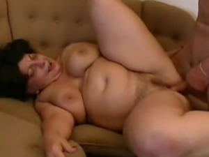 A big babooshka gets busy with a hard young cock and takes a big load over...