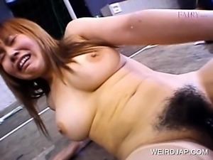 Big titted Asian gets pussy fucked with vibrator