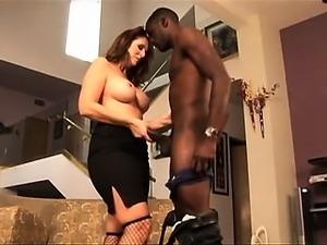 Busty white MILF sucking on giant black cock