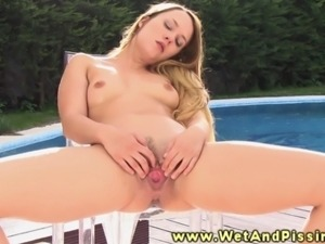 Pee drinking blonde hottie massages clit next to outdoor pool