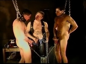 CBT Dual scrotum chain pull by hot studs. Both their balls are chained...