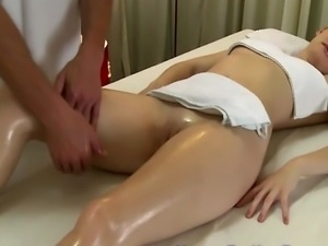 Masseur uses feet on model during her massage session HD