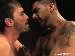 Joe leaps on Adam like a hungry beast in a dingy prison cell