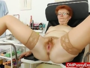 Redhead mature slut gets her hairy pussy examined