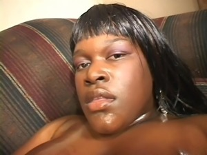 oiled up chubby black whore swallows cock