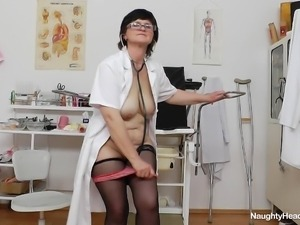 horny nurse examines herself