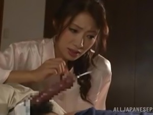 mature japanese lady takes care of a cock