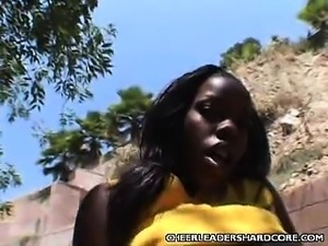 Ebony Cheerleader Showing off Her Pussy