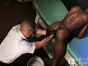 Interrogator Dirk strips Race and probes for a cavity search