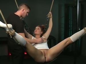 Beautiful submissive girl suspended and fucked