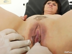 old whore receives a pussy examination
