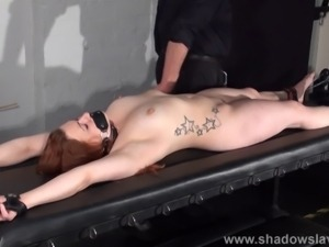 Amateur slave Louise in dungeon rack bondage and hot wax tit punishments of...