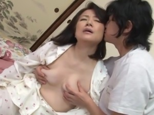 young guy sucks mature tits