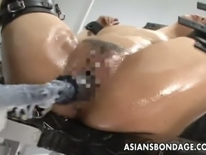 Tied up japanese gets fucked by a nasty machine
