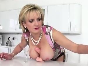 Lady Sonia sucks and tugs dildo