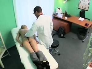 Petite blonde patient gets massaged by her doctor