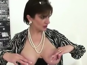 Busty mature Lady Sonia poses