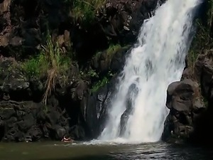Evangeline Lilly washing herself in the ocean and removing