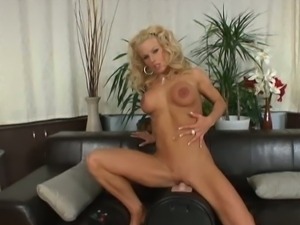 Busty blonde riding the Sybian