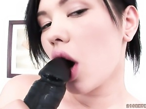 Teen gives a closeup view of her love box while masturbating with toy