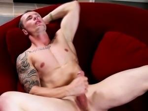 Gay tattooed hunk masturbates