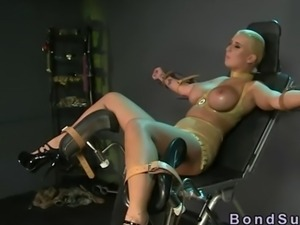 Huge tits blonde in latex bangs in a bdsm scene