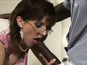 Lady Sonia sucks black dick