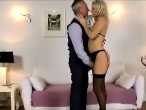 Young blonde slut in stockings sucking older British cock
