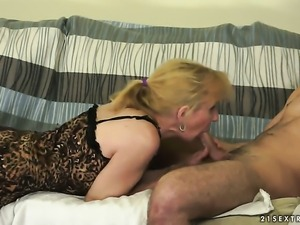 Blonde Nanney enjoys guys meat stick in her mouth in steamy oral action