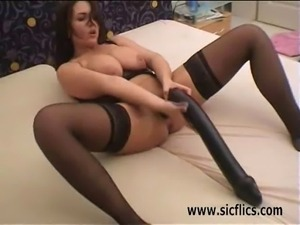 Big tit brunette milf gets  fisted and fucked with a gigantic black dildo in...