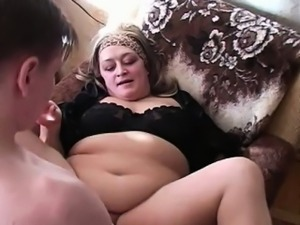 Mature chubby takes cum on face