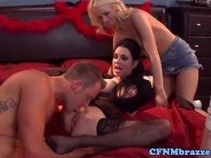 Cfnm femdoms share cock together at home