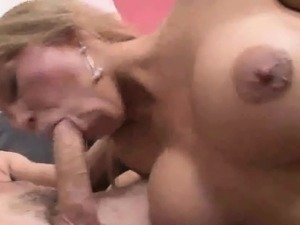 Sexy blonde tranny honey sucks on a studs hard cock