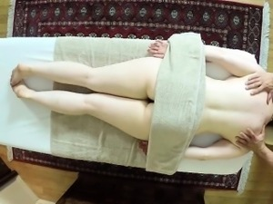 Busty redhead got a massage then sucks cock and titty fucked
