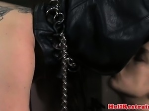 Mistress humiliates a mask wearing female slave
