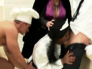 Clothed black maid sucks