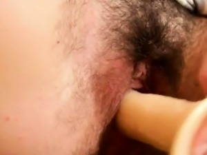 Hairy Cutie Masturbates With A Dildo