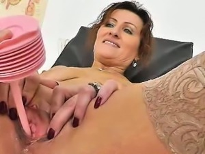 Redhead mother spreads her legs at fetish clinic