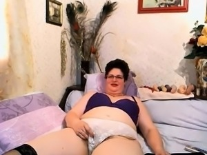 Naughty Granny Teases Her Hairy Pussy