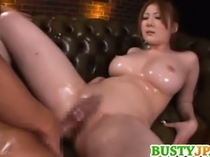 Busty Asian Momoka Nishina gets oiled and fucked