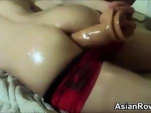 Asian Girl Sticks A Dildo In Her Ass