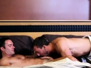 Athletic gay couple closeup at home in bed
