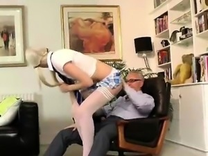 Young blonde in stockings strips for older British dude
