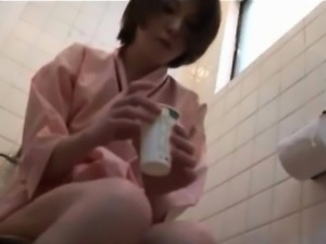 Japanese babe taking a pregnancy test in the bathroom